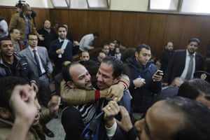 Relatives of 26 men who were arrested in a televised raid by police looking for gay people at a Cairo public bathhouse, celebrate after court acquitted them.