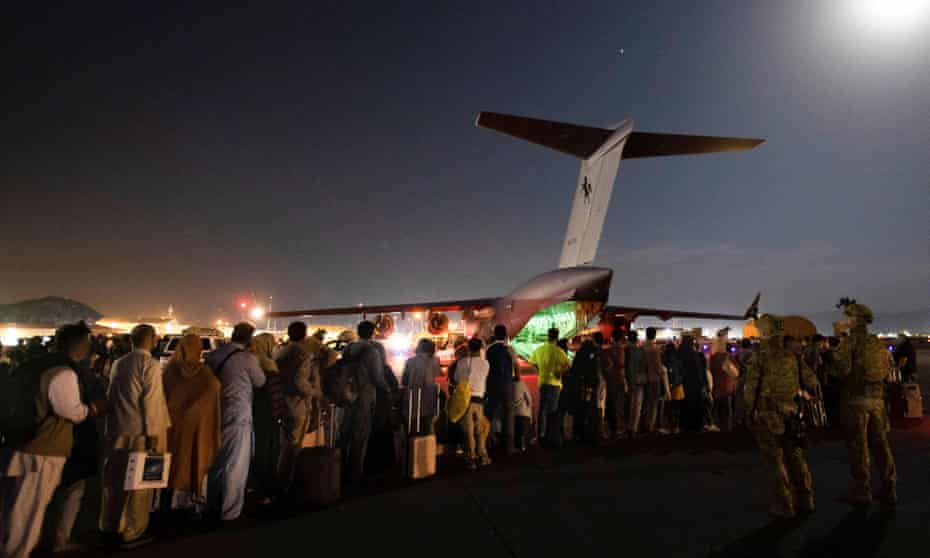 Evacuees board a Royal Australian Air Force C-17 in Kabul