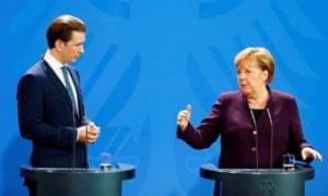 German Chancellor Angela Merkel and her Austrian counterpart Sebastian Kurz attend a news conference after talks at the Chancellery in Berlin.