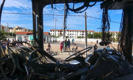 The remains of a burnt-out vehicle after an attack in Fortaleza