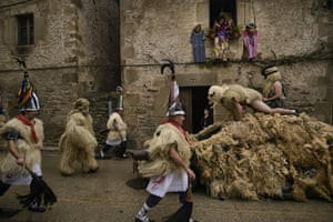 Joaldunaks march along the street as they take part in a carnival in the small Pyrenees village of Ituren.