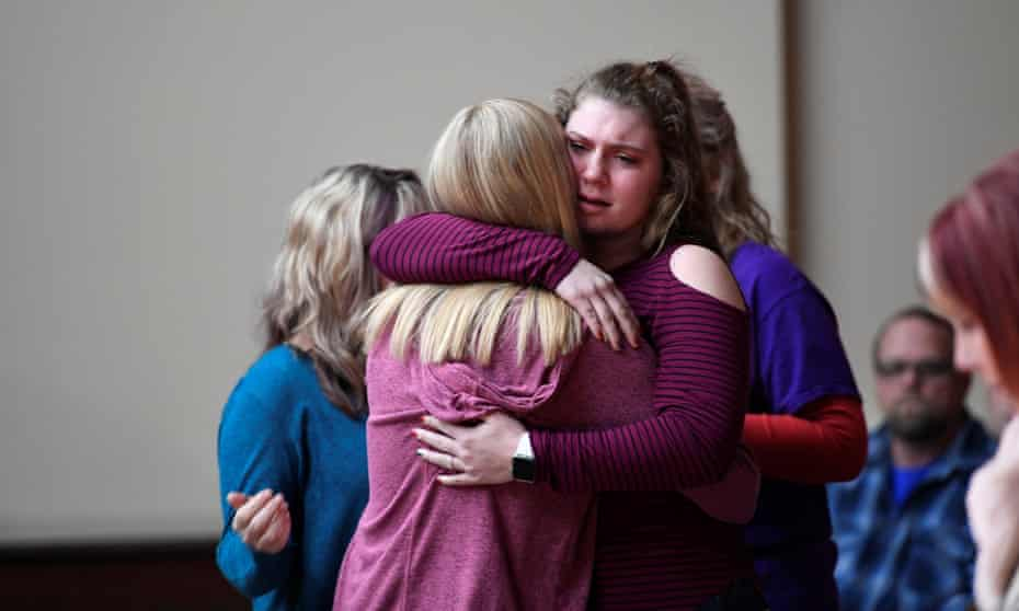 Students attend a vigil for those killed and injured after a 15-year-old boy opened fire at Marshall County High School in Marion, Kentucky Tuesday.