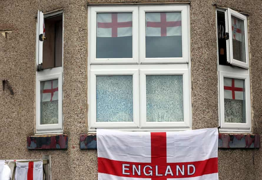 St George's cross flags hanging on the front of a house