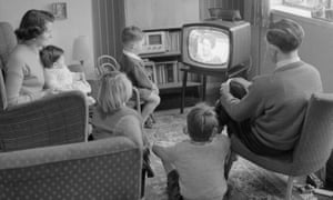 Family watching black and white television at their home in May 1958.