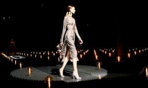 A model presents a creation by Prada.