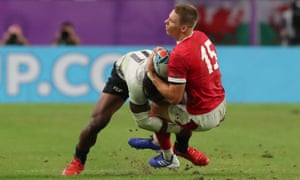 Liam Williams of Wales is tackled by Semi Radradra of Fiji.