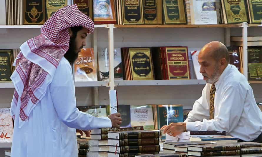 A customer and a stall owner in conversation at the Kuwait international book fair in Kuwait City, in 2019.