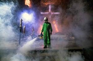Worker disinfects underground church