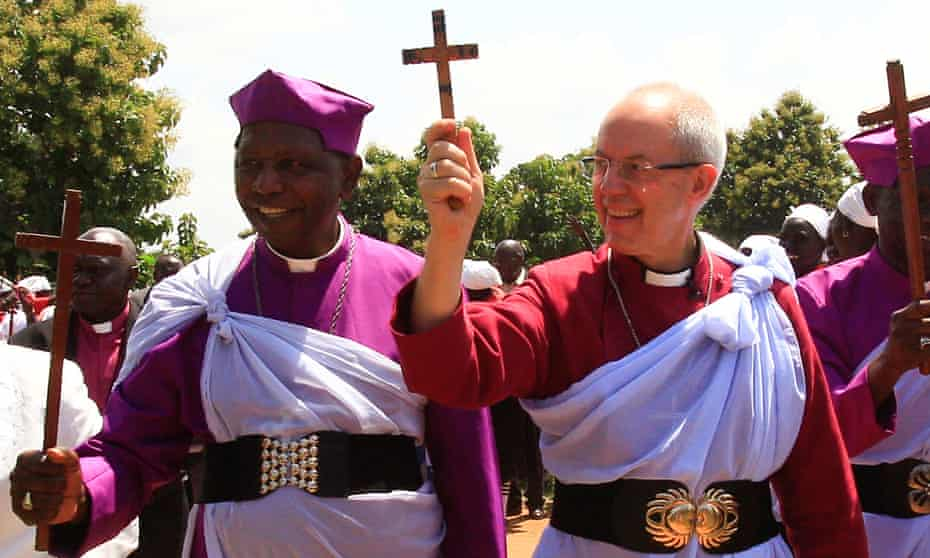 Archbishop of Canterbury Justin Welby and his Ugandan counterpart, the Rev Stanley Ntagali, arrive at a camp in Uganda to visit South Sudanese refugees.