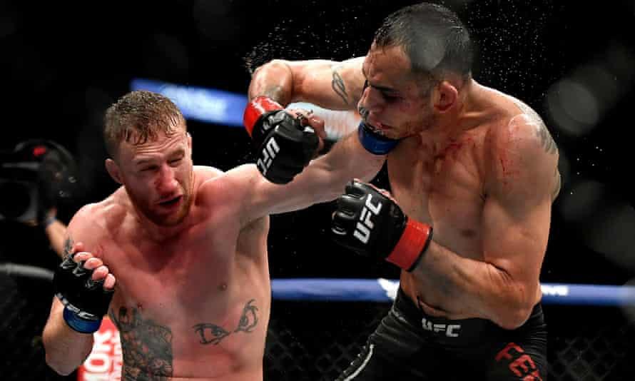 Justin Gaethje (left) lands a powerful jab on Tony Ferguson to help earn a shot at Khabib Nurmagomedov for the undisputed lightweight crown.