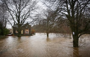 A house cut off by floodwater near the River Tweed at Peebles in the Scottish Borders