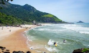 Surfers on Prainha beach, Barra da Tijuca.
