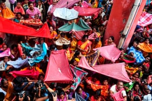 Hindu devotees collect rice as offerings at the Madan Mohan temple in Kolkata, India
