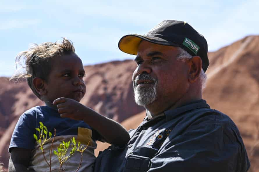 Sammy Wilson, chairman of the Central Land Council, with his grandson Jacob at Uluru-Kata Tjuta national park.