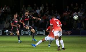 Mateusz Klich fires in Leeds's third goal against Salford City.