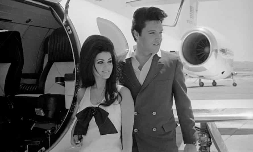 Newlyweds Elvis and Priscilla prepare to board their private jet following their wedding in Las Vegas