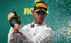 Lewis Hamilton celebrates his win at the F1 US Grand Prix that keeps him in touch with his Mercedes team-mate Nico Rosberg.