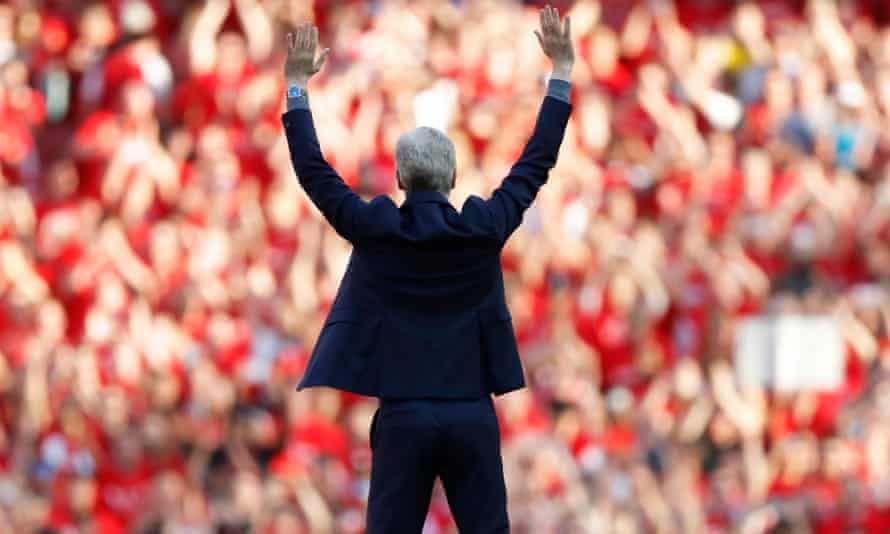 Arsène Wenger waves goodbye to the Emirates crowd from the centre circle after the final whistle.