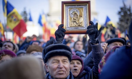 Moldovans protest outside parliament in the capital, Chisinau, after the country's third government within a year was sworn in.
