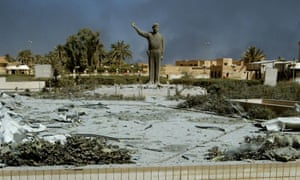 Statue of Saddam Hussein in front of a bombed-out communication centre in Baghdad in March 2003.