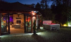 Cuan Mor exterior at night with hot tub