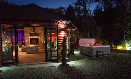 Cuan Mor exterior at night with hot tub