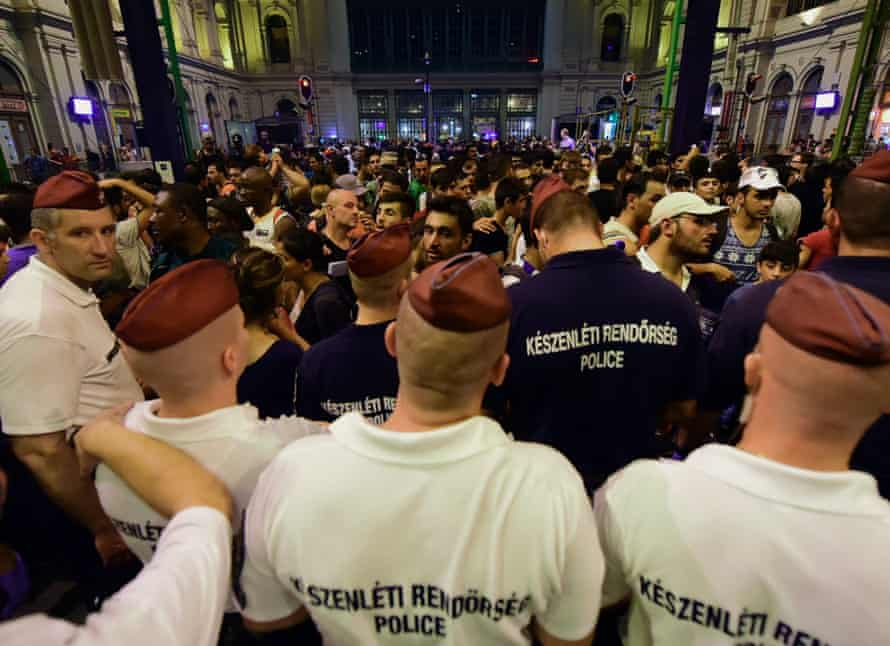 Police form a line at the Keleti (Eastern) railway station in Budapest.