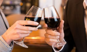 Close-up of Couple Toasting with red wine glass