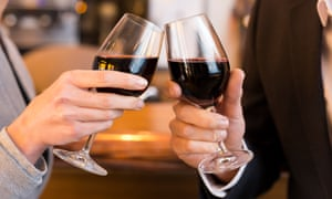 Couple toasting with red wine glass