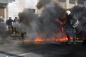 GREECE-ATHENS-PROTEST-AUSTERITY MEASURES<br>12 Nov 2015, Athens, Attica, Greece --- (151112) -- ATHENS, Nov. 12, 2015 (Xinhua) -- Greek riot police clash with protesters in central Athens, Greece, Nov. 12, 2015. Greece was hit on Thursday by a 24-hour nationwide general strike called by trade unions protesting the new round of austerity measures imposed to redress a six-year debt crisis. (Xinhua/Marios Lolos) --- Image by © Marios Lolos/Xinhua Press/Corbis