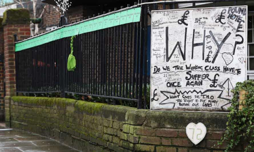 A piece of green ribbon hangs from a railing in Silchester Road, London, which bears placards of all of the names of the victims of the Grenfell Tower fire.