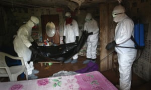 A burial team retrieve the body of a 60-year-old Ebola victim from his home near Monrovia, Libera, in August 2014