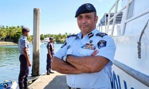 Fiji police commissioner Brigadier General Sitiveni Qiliho next to the police patrol boat Veiqaravi