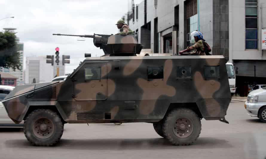 Armed soldiers patrol the Zimbabwean capital Harare on 21 January.