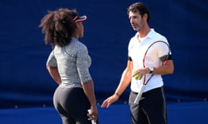Serena Williams discusses tactics with her coach Patrick Mouratoglou during a practice session.