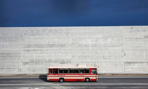 A bus drives past a seawall in Yamada, Iwate prefecture, Japan, in 2018.