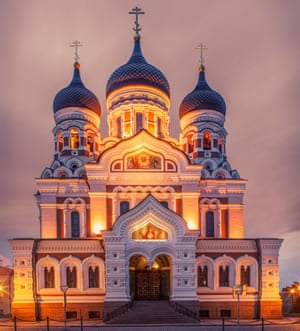 The floodlit, Russian-styled Alexander Nevsky Cathedral, a building in three tiers with domes, spires and arches