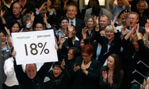 John Lewis staff cheer their 18% bonus in 2011; it is likely to be less than 10% this year.