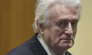 Radovan Karadžić enters the courtroom in The Hague