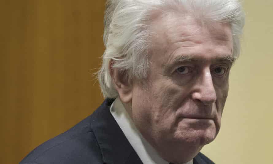 Radovan Karadžić enters the courtroom in The Hague