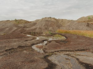 Veliki Crljeni, Kolubara coal basin, Serbia: The immense weight of ash deposits from a nearby coal plant disrupt and pollute the water table, causing water to pool on the surface, leading to water shortages in neighbouring villages