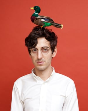 A man with a bird on his head, from photographer Olivia Locher's I Fought the Law series