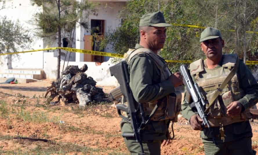 Tunisian soldiers stand guard at scene of  attack at Ben Guerdane near Libyan border