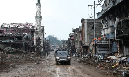A convoy carrying Philippine president Rodrigo Duterte visits the conflict-torn Marawi City in October.