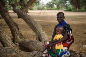 Akuwom Atiir, around age 20, at home in Kachemeri village, Loima sub-county, Turkana, Kenya on 18 October 2017
