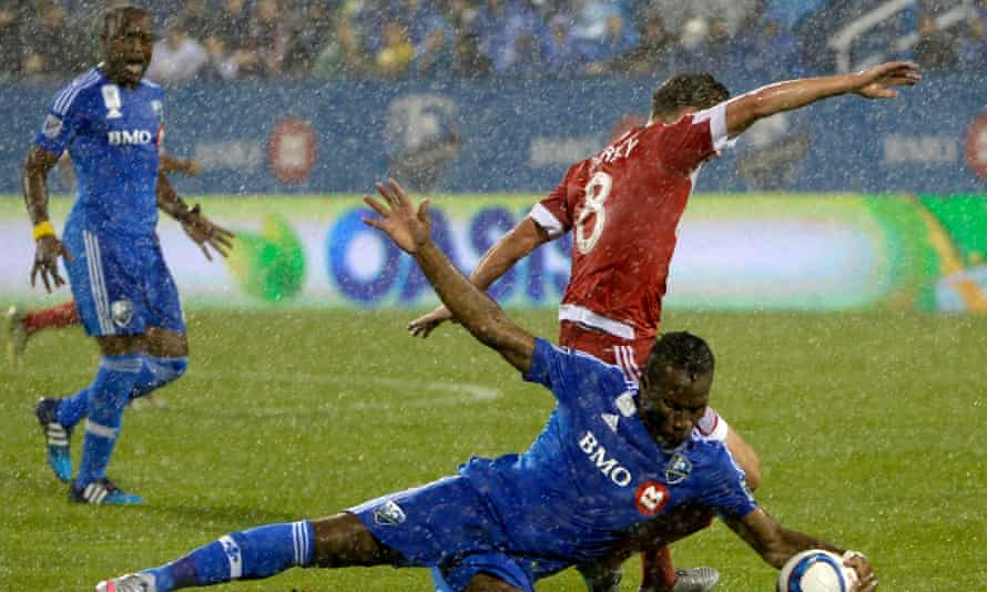 Didier Drogba goes down against the Revolution.