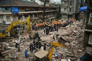 Mumbai, India: Rescue workers look for survivors in the debris of a collapsed building in Mumbai after heavy rains wreaked havoc in many parts of South Asia