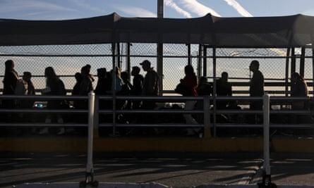 Central American migrants wait at the Paso del Norte international bridge on 29 October 2018.