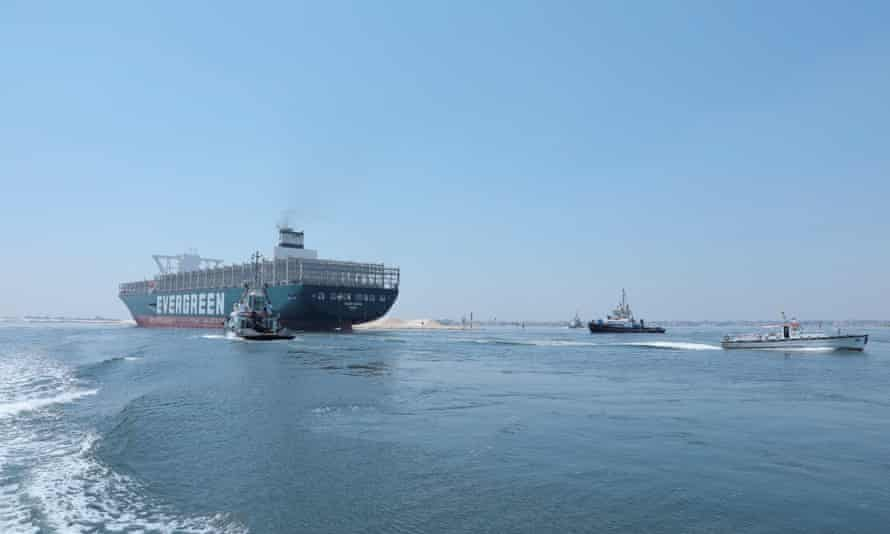 The Ever Given sails through the Suez canal in Ismailia, Egypt.