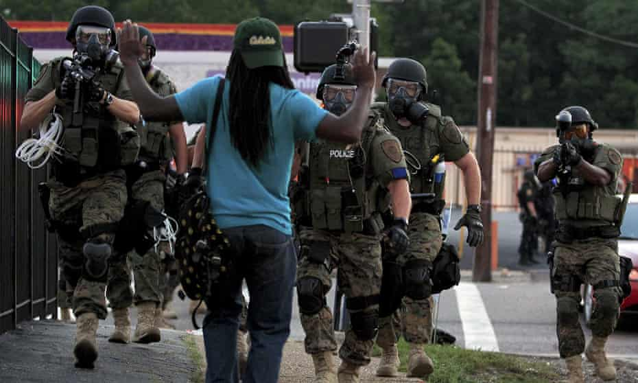 Heavily armed police on the streets of Ferguson in 2014.